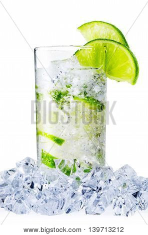 Misted glass of water with lime and ice isolated on white background