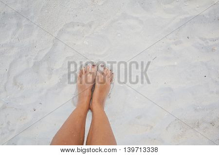 Closeup Photo Legs Young Girl Relaxing Sand Beach.Highly Detailed Image Background.Horizontal picture