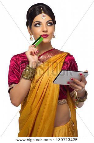 Indian woman with tablet PC and plastic card isolated