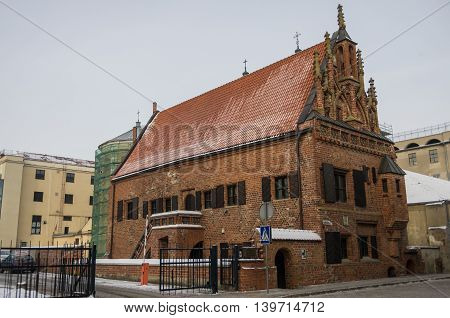 Kaunas, Lithuania - January 3, 2016: Brick medieval The House of Perkunas (Thunder) built in 15th century is the oldest structure in Kaunas Lithuania