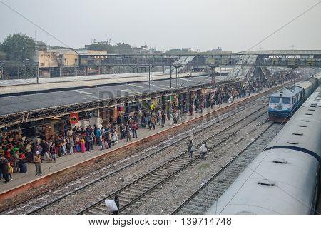 Delhi, India - January 10, 2012: Crowded train platform in New Delhi railway station.