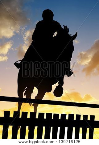 Silhouette of a rider on a horse jumping over obstacle at sunset.