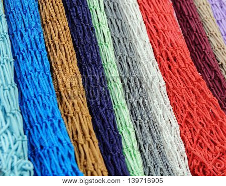 colorful grid of cord hanging vertically in the form of multi-colored background