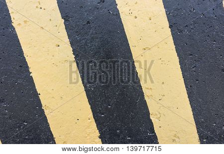 Yellow and black stripes on the concrete surface