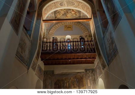 VELIKY NOVGOROD RUSSIA-JULY 15 2016. Architecture elements- decorated arched ceiling with colorful paintings of Bible scenes and choirs in the interior of St Nicholas Cathedral. Soft filter applied