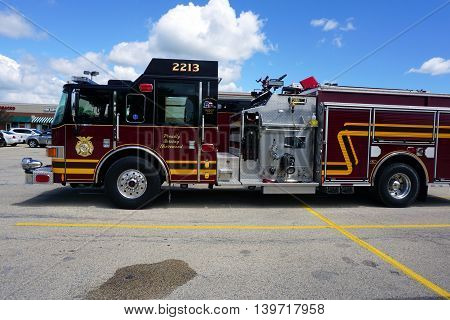 SHOREWOOD, ILLINOIS / UNITED STATES - JULY 15, 2016: A fire engine is parked in a Shorewood parking lot.