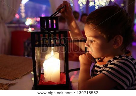 Kid Looking At Candle