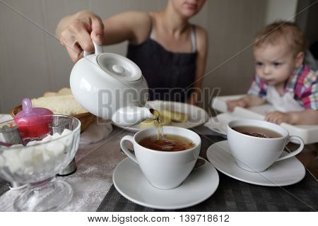 Mother Pouring Tea