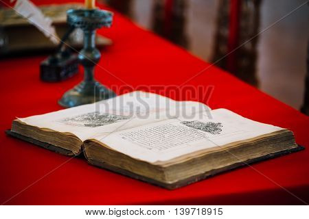 Suzdal, Russia - May, 22, 2015: Very old medieval open book on table