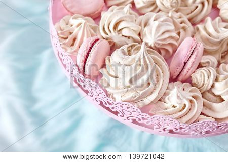 Homemade Pink And White Meringues On A Plate.
