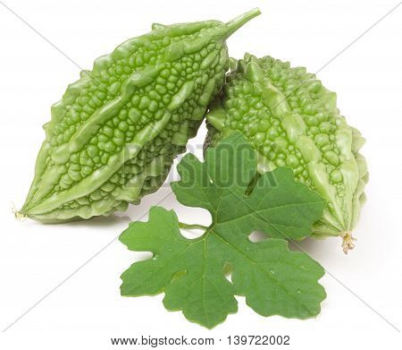 two green momordica or karela with leaf isolated on white background.