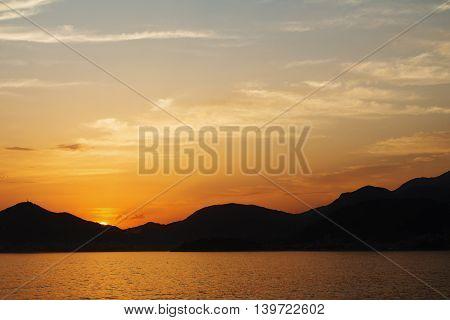 Beauty nature sunset at sea mountain background