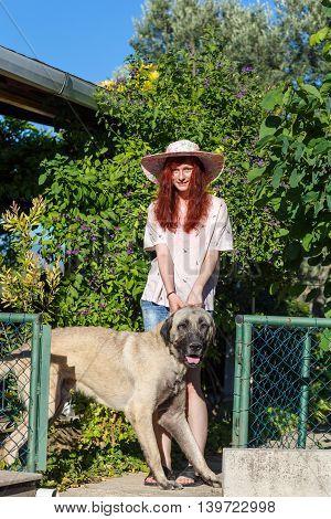 Young Girl And Kangal Dog