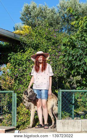 Young Girl And Turkish Kangal