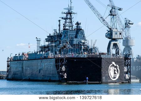 Baltiysk, Russia - June 29, 2010: Military ship for repairs in large floating dry dock