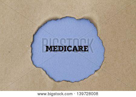 MEDICARE word written under torn paper concept.