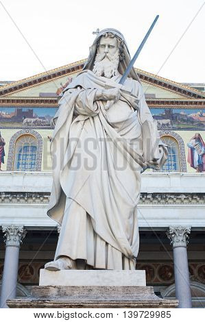 St Paul holding a sword statue outside basilica in Rome Italy