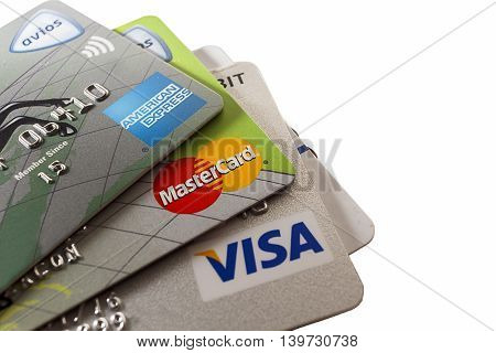 LONDON - SEPTEMBER 2015: Close up shot of the three major credit cards white background. Editorial