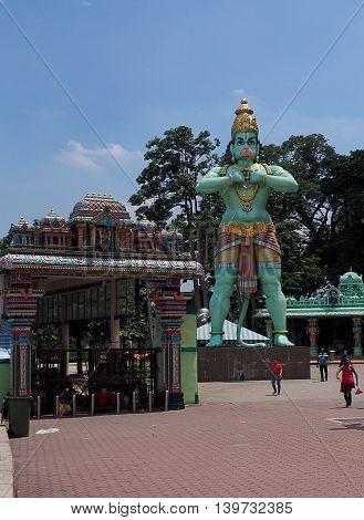 Lord Muruga of Batu Caves. Batu, Malaysia - June 01, 2016 Tall statue of half-man, half-ape - Lord Muruga with complex Cave Batu in Malaysia.