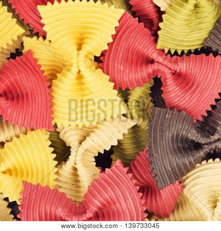raw bow-knot pasta of different color, background