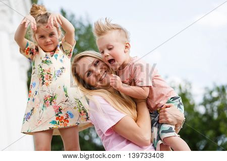 beautiful young girl playing with her children