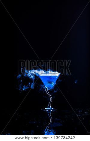 blue cocktail with dry ice vapor