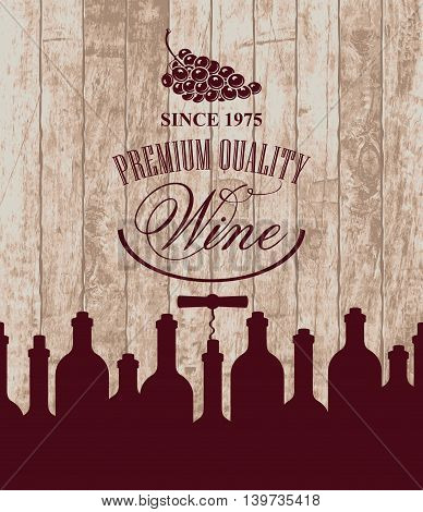 banner for the wine store or restaurant with bottles and grapes on the background of wooden boards