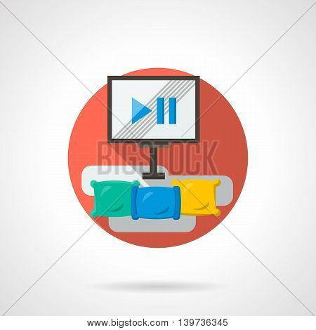 Watching movie with enhanced comfort. Monitor and three colored pillows. Cinema room comfortable interior. Round detailed flat color style vector icon.