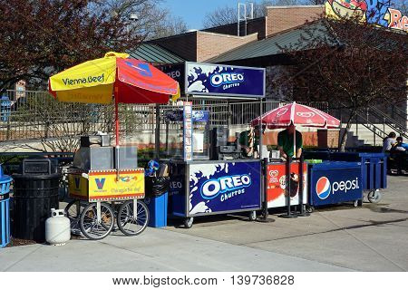 BROOKFIELD, ILLINOIS / UNITED STATES - APRIL 23, 2016: Vendors sell hot dogs, ice cream and carbonated beverages outdoors at the Brookfield Zoo.