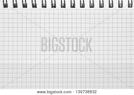 Checked spiral notebook background pattern, horizontal chequered squared open notepad copy space, stapled blank empty blocknote, reminder concept metaphor, large detailed macro closeup