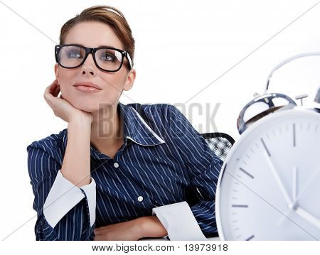 young businesswoman with a big clock