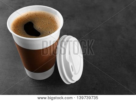 Coffee-to-go. Paper cup of coffee on the table