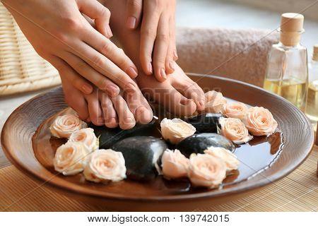 Female feet treatment. Spa concept