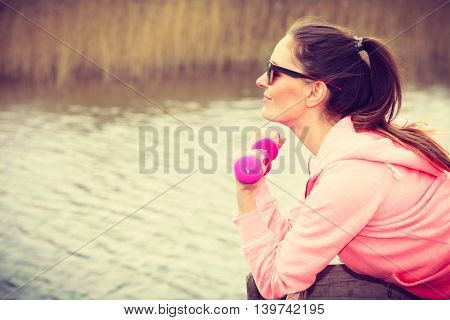 Woman Exercising With Dumbbells Outdoor