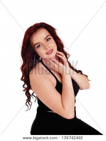 A happy young woman in a portrait image holding both hands on her face isolated for white background.