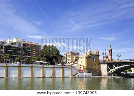 SEVILLE, SPAIN - September 13, 2015: Famous neighbourhood on the west bank of the Guadalquivir River on September 13, 2015 in Seville, Spain