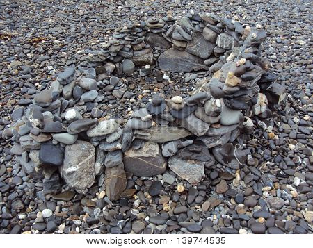 Stone pile upon beach photographed at Crackington Haven in Cornwall