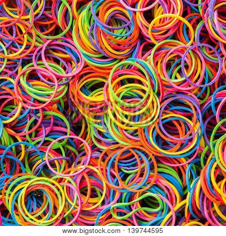 Close up group of colorful elastic bandon  background