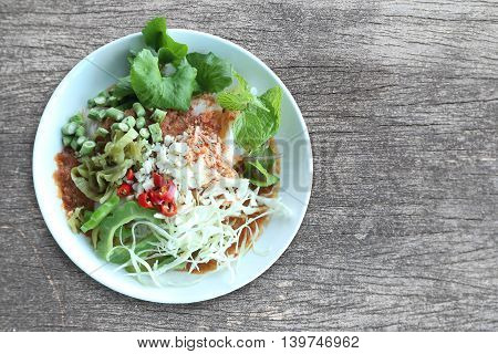 Local Thai foods of Rice Vermicelli is name KHANOM CHINspicy noodles with vegetable and hot soup.