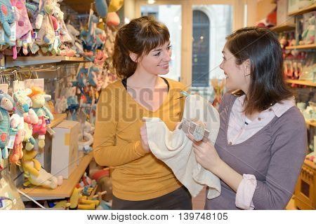 happy mothers shopping at toy store