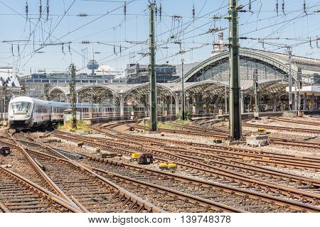 white train depart from the station Cologne Germany.