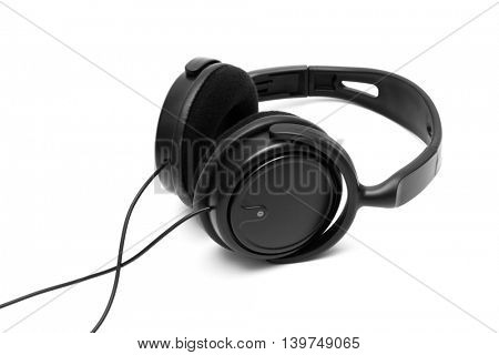 Modern black earphones on a white background