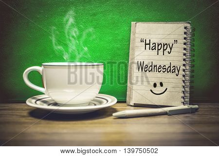 Inspirational quote - Happy Wednesday on notepad retro style background. Focus Text message on notepad area .