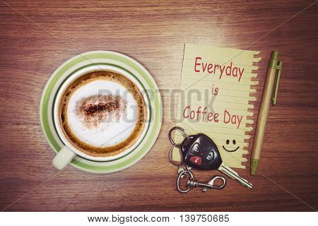 Inspirational quote - Everyday is Coffee Day on notepad retro style background.