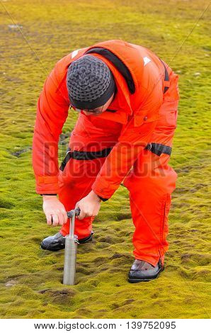 The man drill to collect soil sample at Antarctica