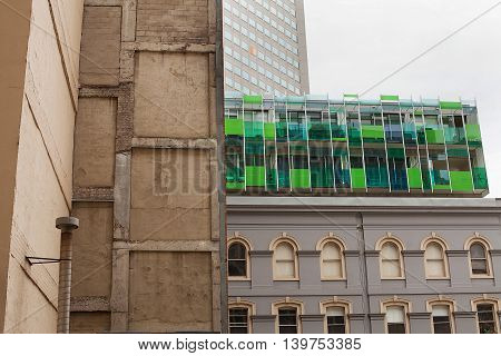 View from below of funky modern apartments built on top of older building