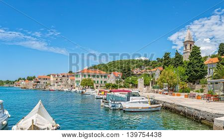 PRVIC LUKA, CROATIA - June 5, 2016 Boats anchored in the town port at beautiful summer day.