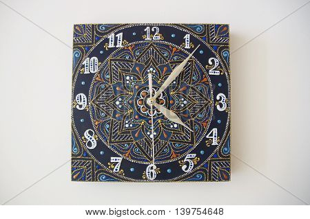 blue square hand-painted watch with contour acrylic paints in the technique point to point, with a geometric pattern in the form of a mandala, white numerals and silver arrows