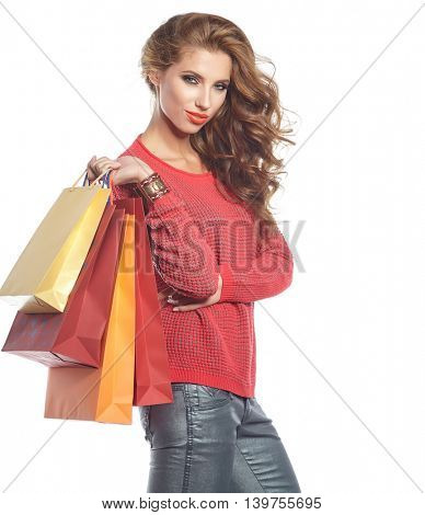 Photo of young sexy woman with shopping bags