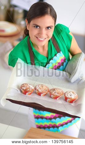 Woman is making cakes in the kitchen, isolated